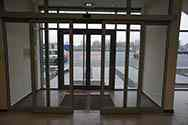 Aluminium system sliding door at the entrance to a building. Equipped with automatic sliding mechanism based on motion sensors
