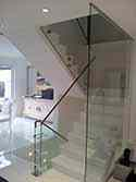 Frameless glass balustrade with aluminium handrail on the main stairs.