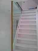 Steel stairs with glass partition wall