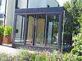 Glass conservatory constructed as a steel frame structure glazed with laminated safety glass
